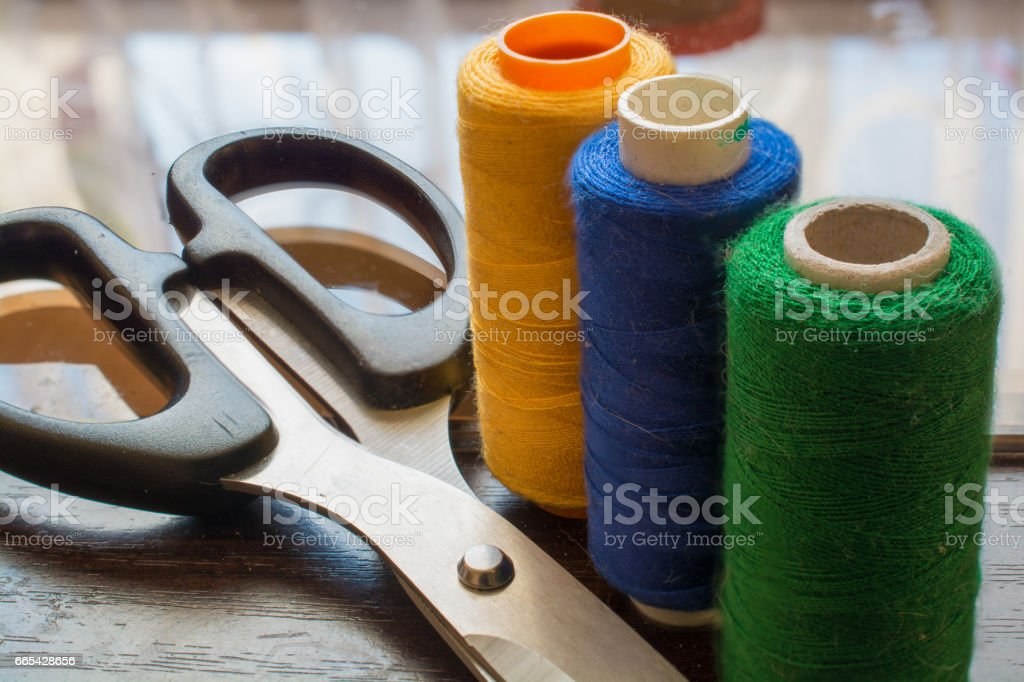 Sewing Threads and Scissors. stock photo