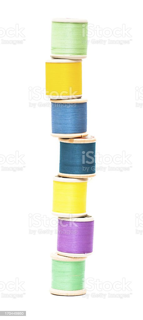 Sewing threads haphazardly stacked royalty-free stock photo