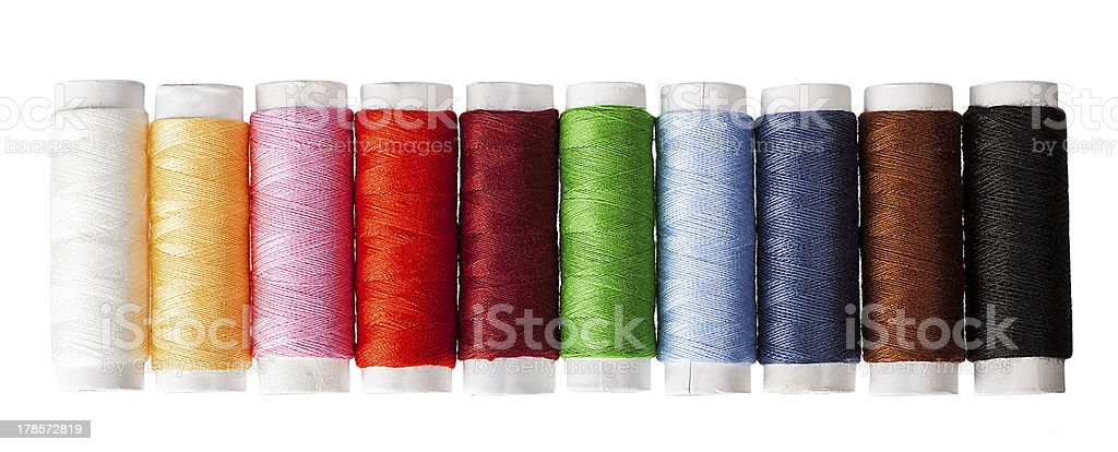 Sewing threads multicolored isolated on white royalty-free stock photo