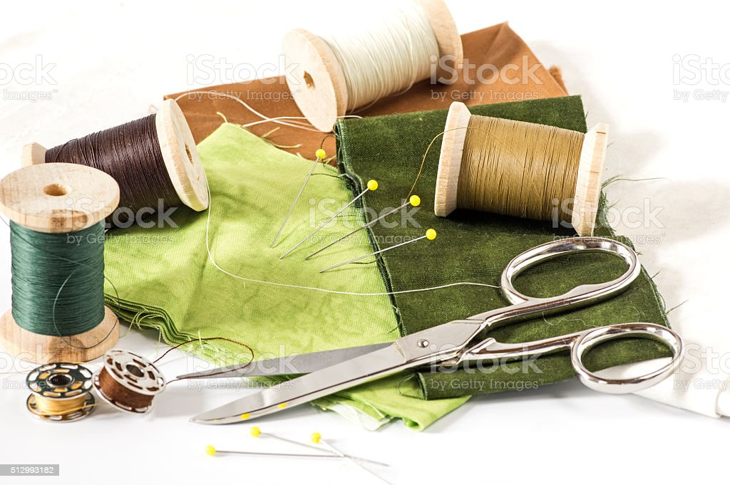 Sewing tools and green fabric stock photo