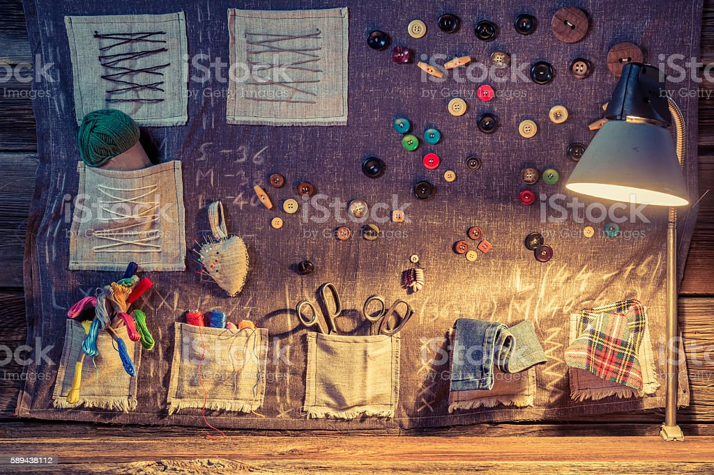 Sewing workshop with cloths and various accessories stock photo