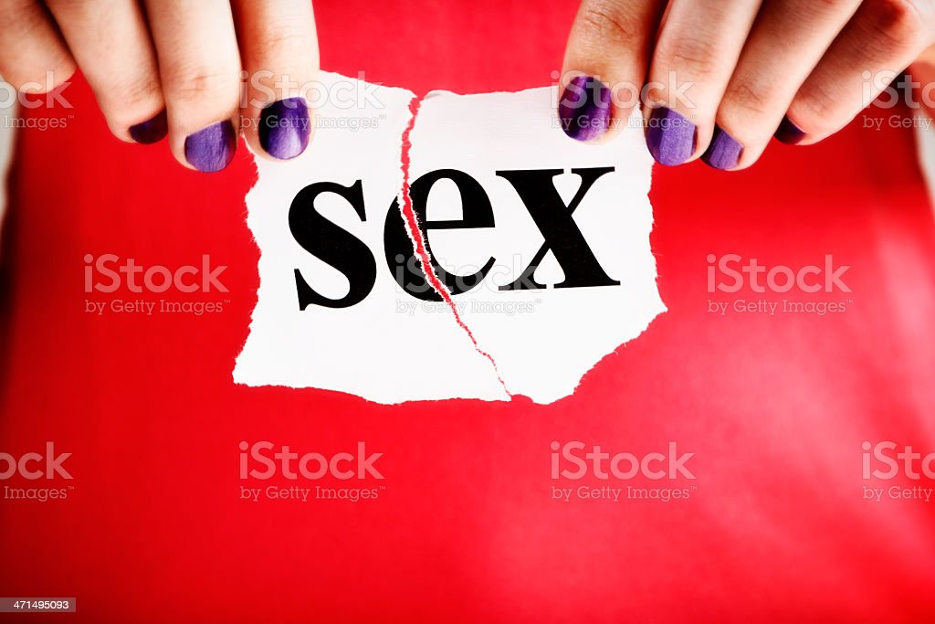 Sex? Forget it! Female hands rip up sign stock photo