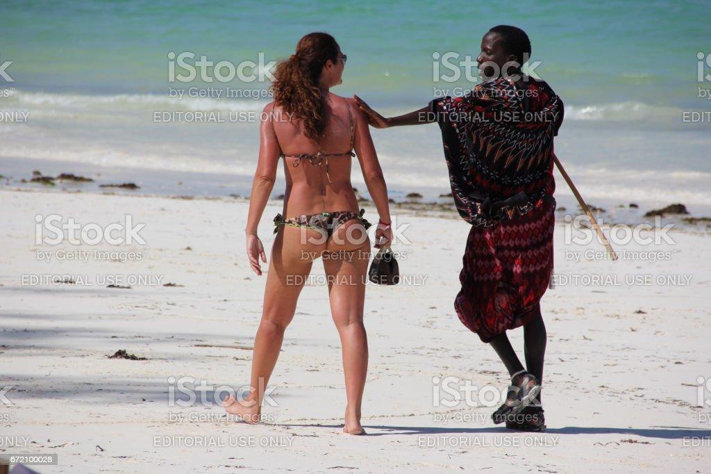 Masai sell souvenirs to tourists at the beach of Kiwengwa on Zanzibar...