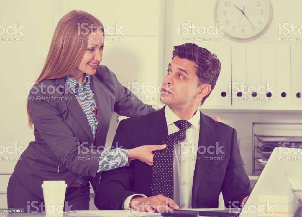 Sexual harassment between colleagues stock photo