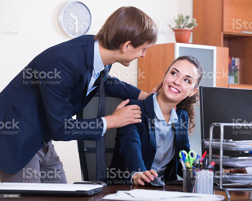 Sexual harassment in office stock photo