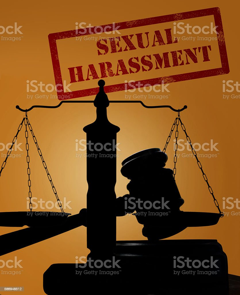 Sexual Harassment stamp and gavel with scales stock photo