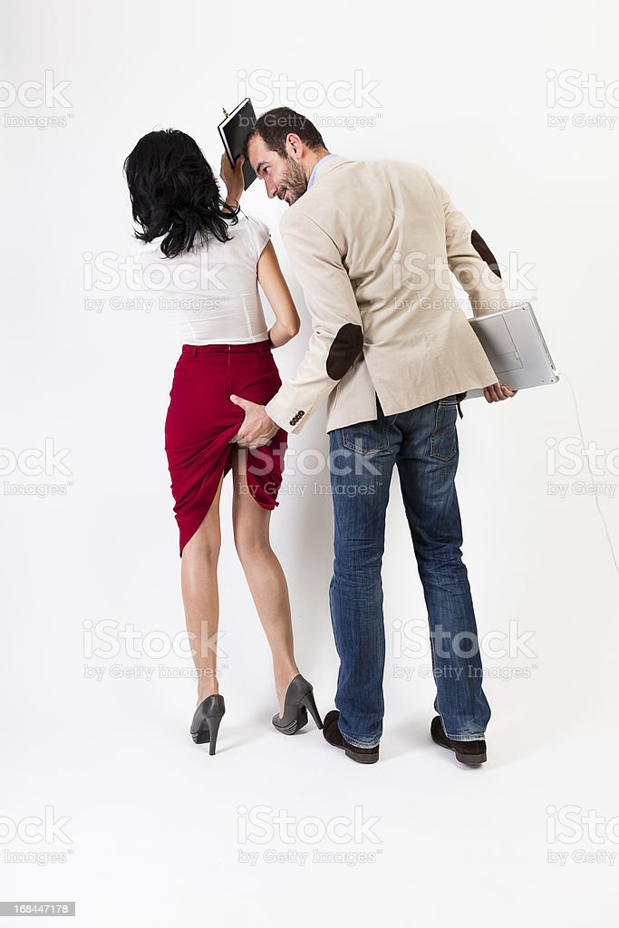 Sexual harassment. Woman hitting the aggresor  with her agenda royalty-free stock photo
