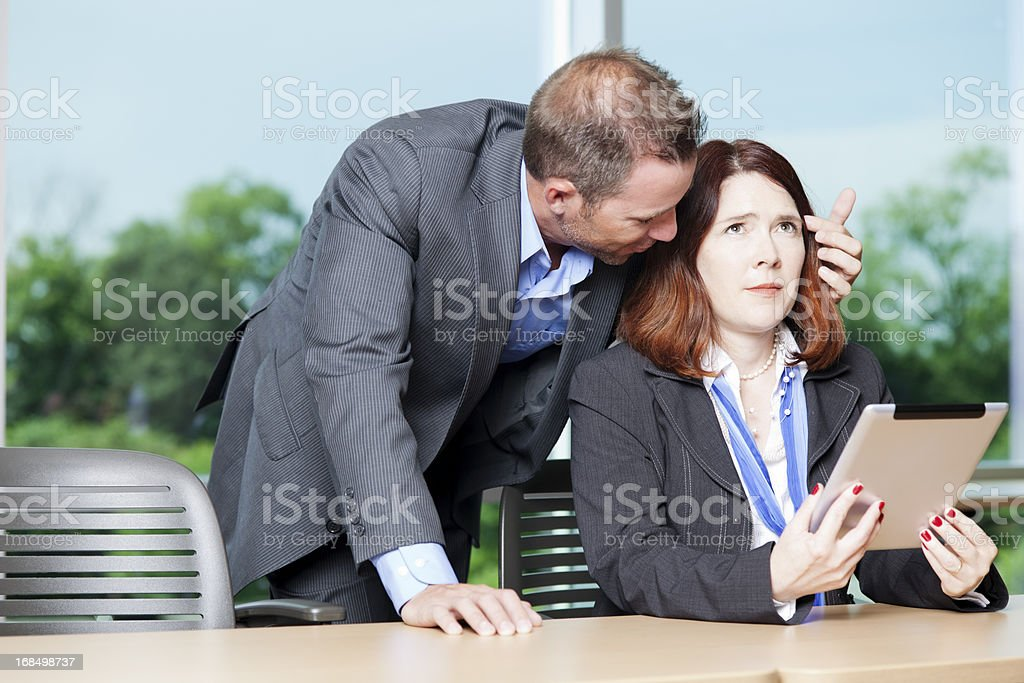 Sexual harrassment in the workplace royalty-free stock photo