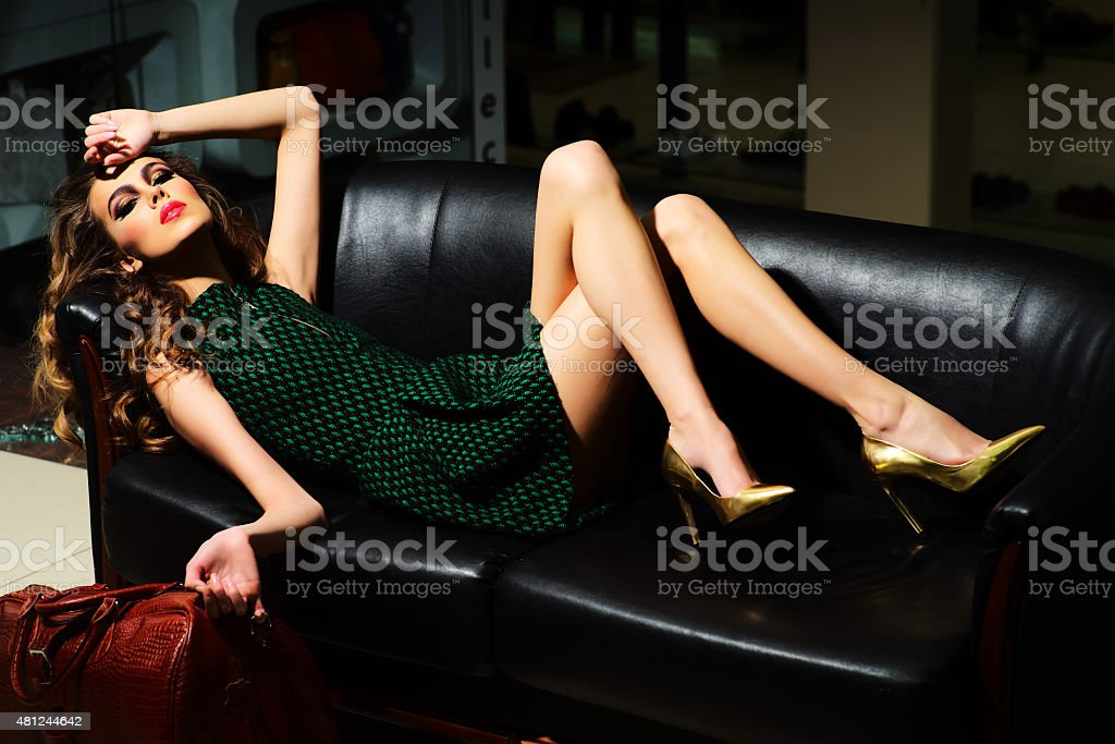 Sexual woman on sofa stock photo