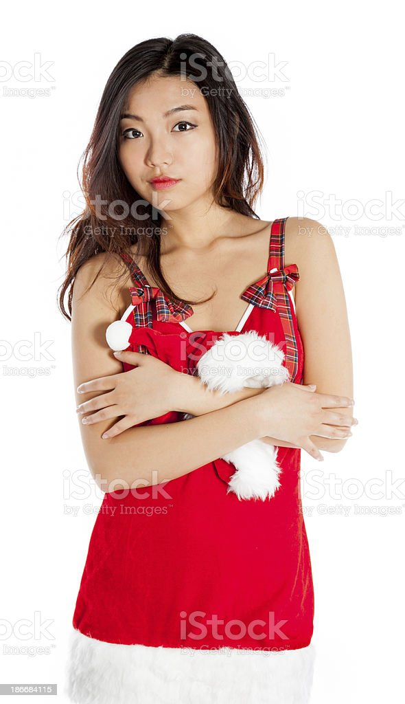 Sexy asian santa claus holding a hat royalty-free stock photo