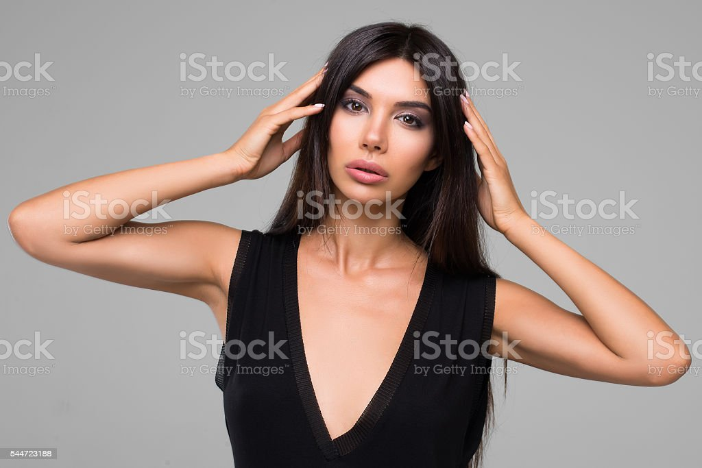 Sexy Beautiful Brunette Woman In Black Dress stock photo