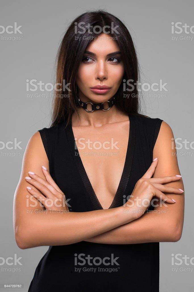 Sexy Beautiful Brunette Woman In Black Dress stock photo