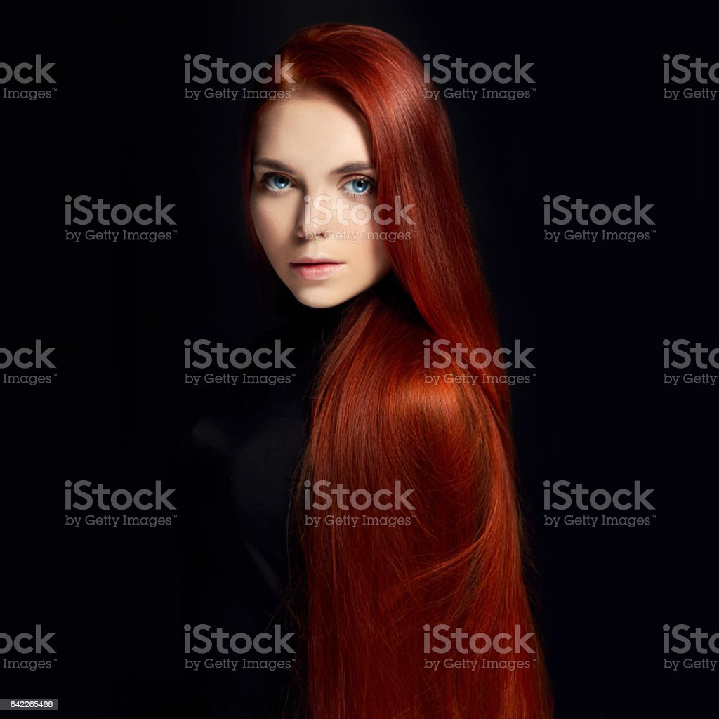 Sexy beautiful redhead girl with long hair. Perfect woman portrait on black background. Gorgeous hair and deep eyes. Natural beauty, clean skin, facial care and hair. Strong and thick hair stock photo