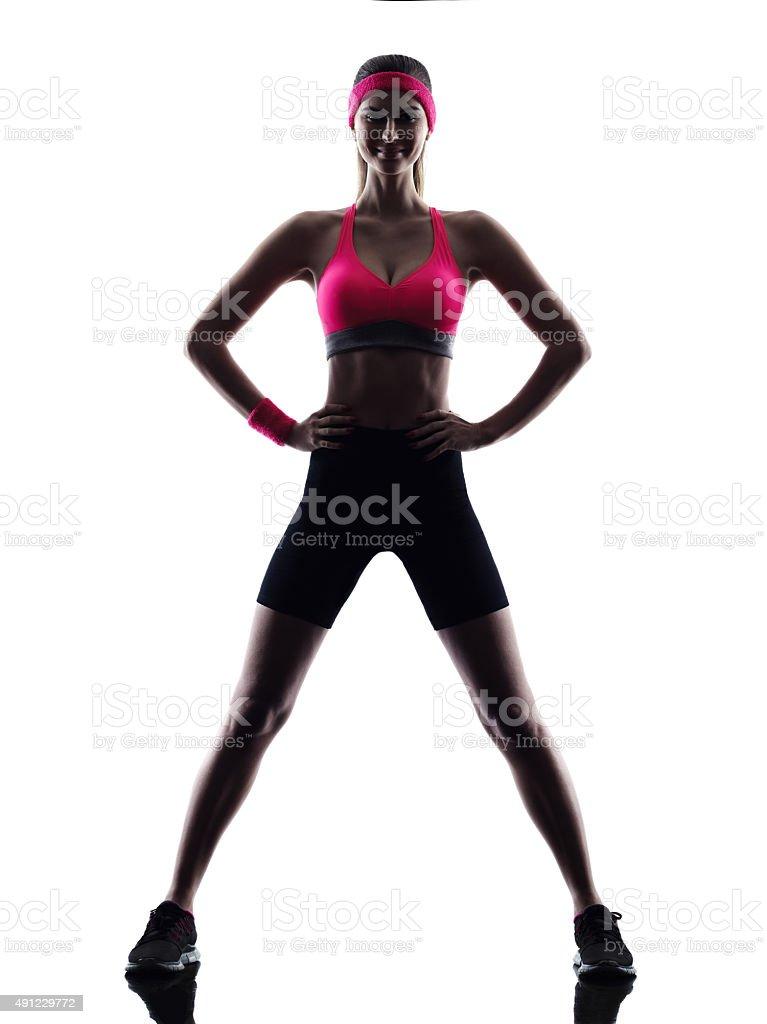 sexy beautiful woman fitness standing silhouette stock photo