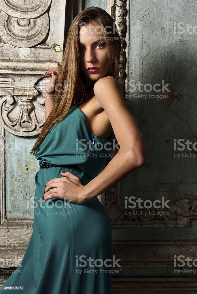 Sexy beautiful woman green gown in palace. stock photo