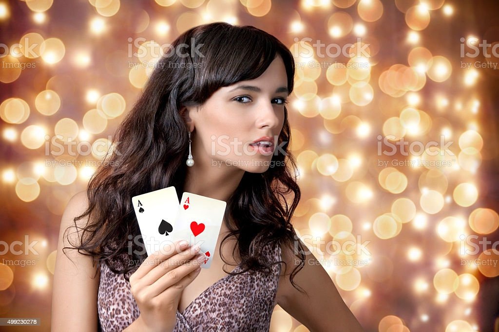 Sexy beautiful young girl in casino on the background bokeh stock photo