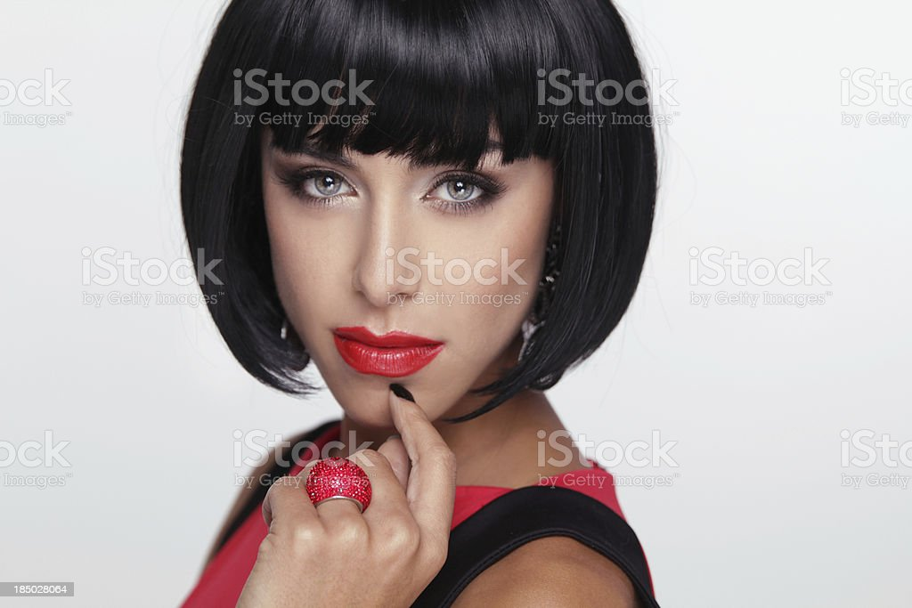 Sexy beauty brunette woman with Red Lips. Makeup. Stylish Fringe royalty-free stock photo