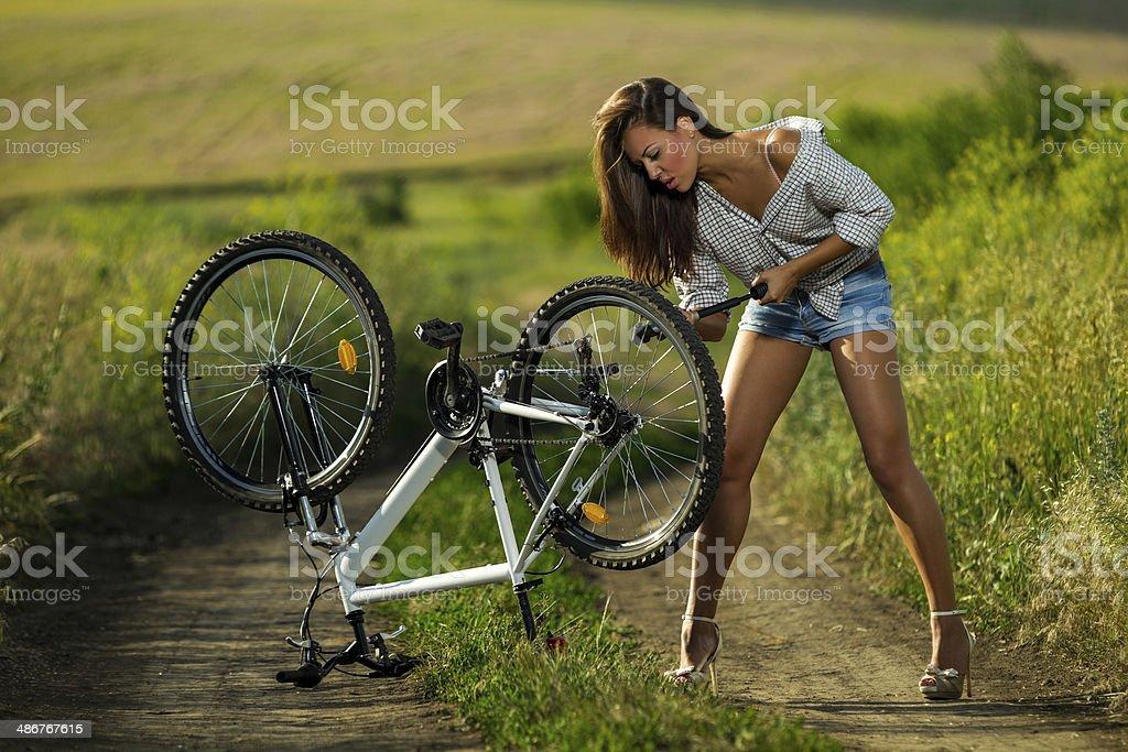 Sexy biker stock photo
