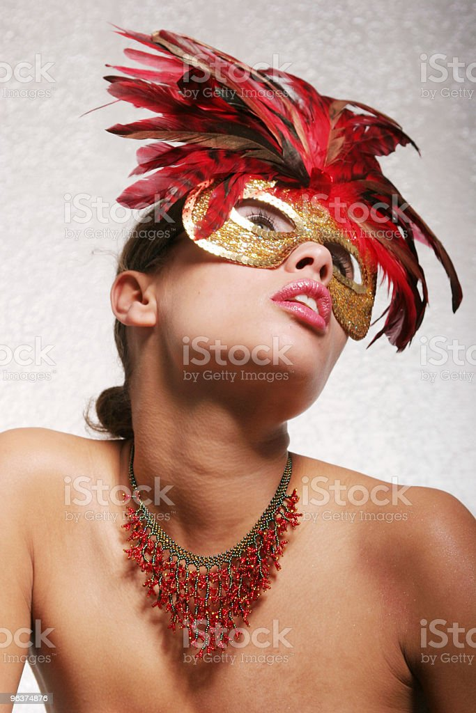 Sexy biracial woman in mask royalty-free stock photo