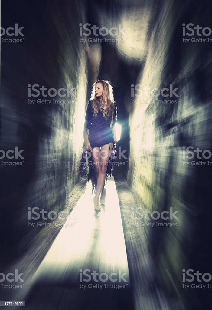 Sexy blond lady through the rocks stock photo