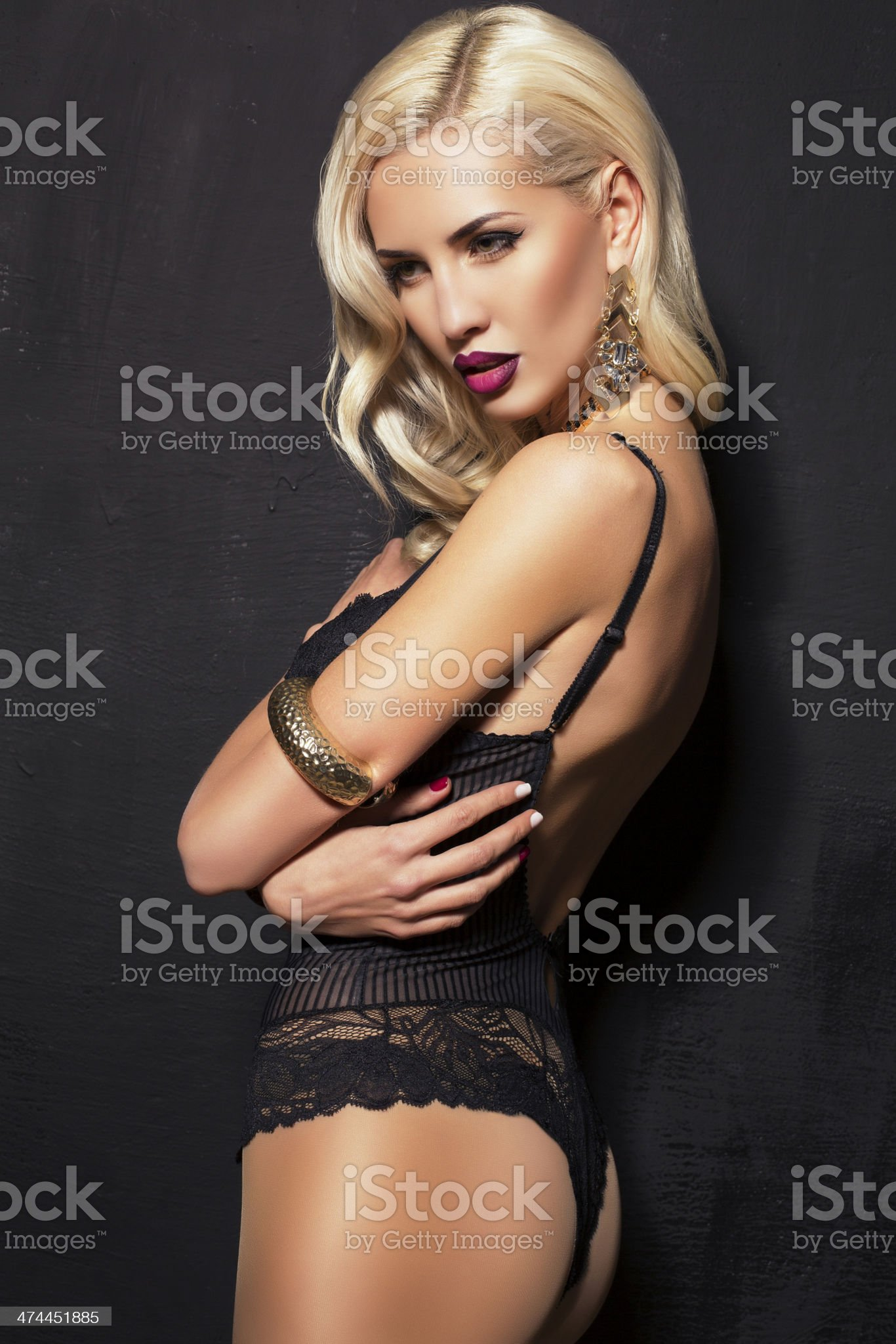 sexy blond woman in black lingerie with bijouterie royalty-free stock photo