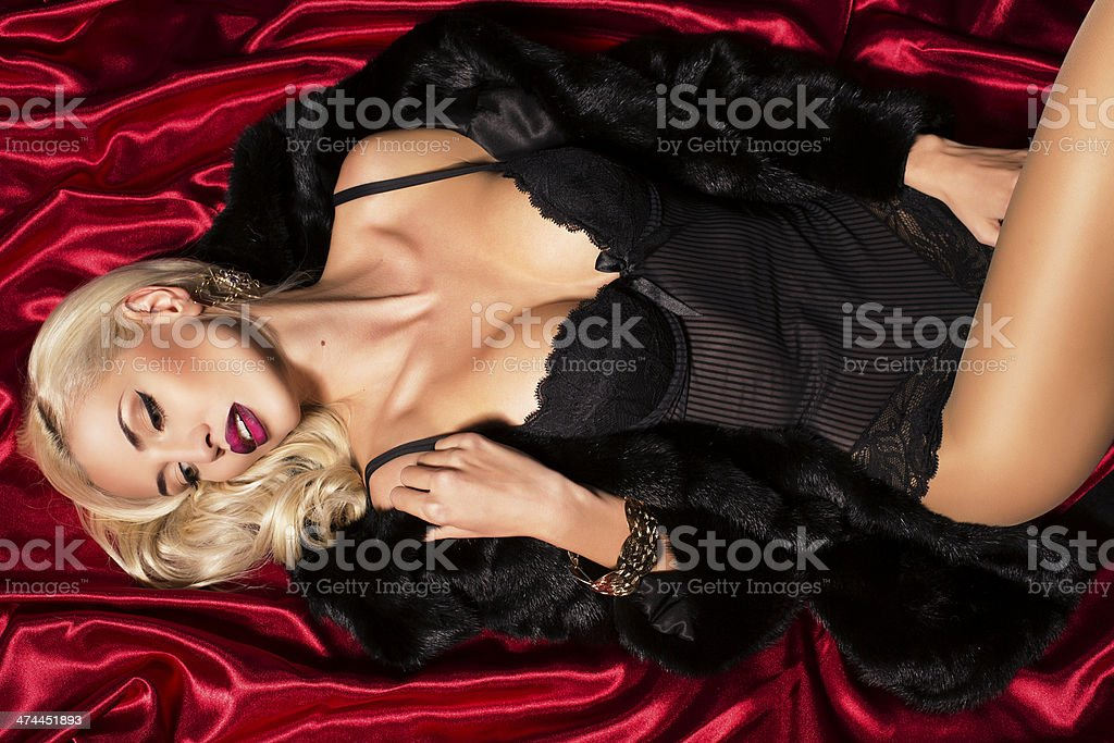 sexy blond woman in fur coat stock photo