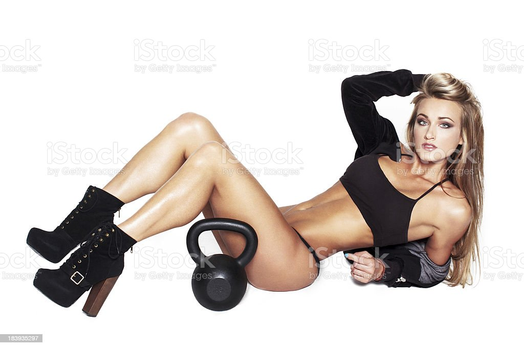 Sexy blonde fitness model with kettlebell royalty-free stock photo