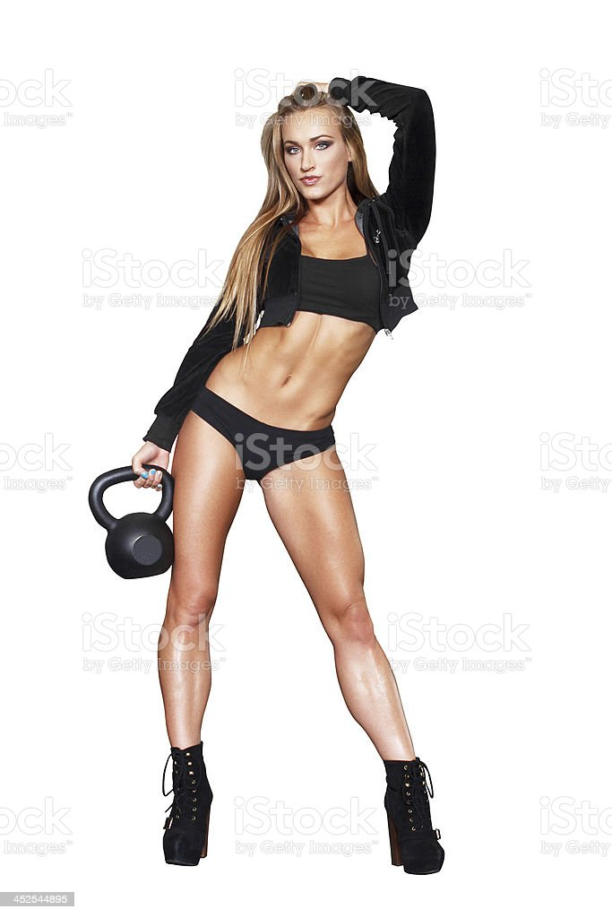 Sexy blonde fitness woman with kettlebell royalty-free stock photo