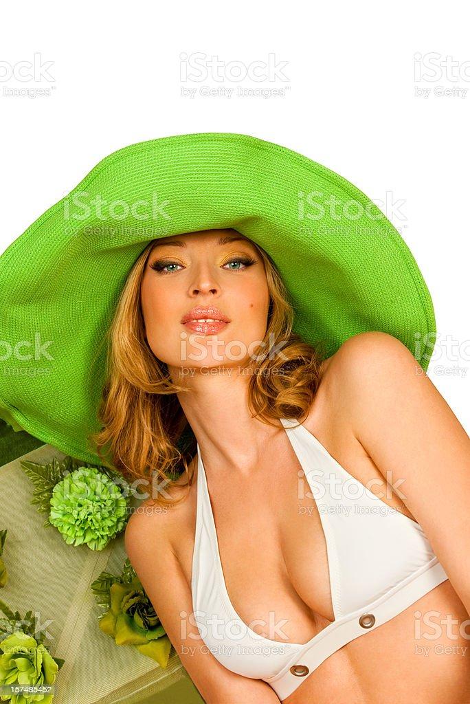 Sexy blonde in bikini and green hat. royalty-free stock photo