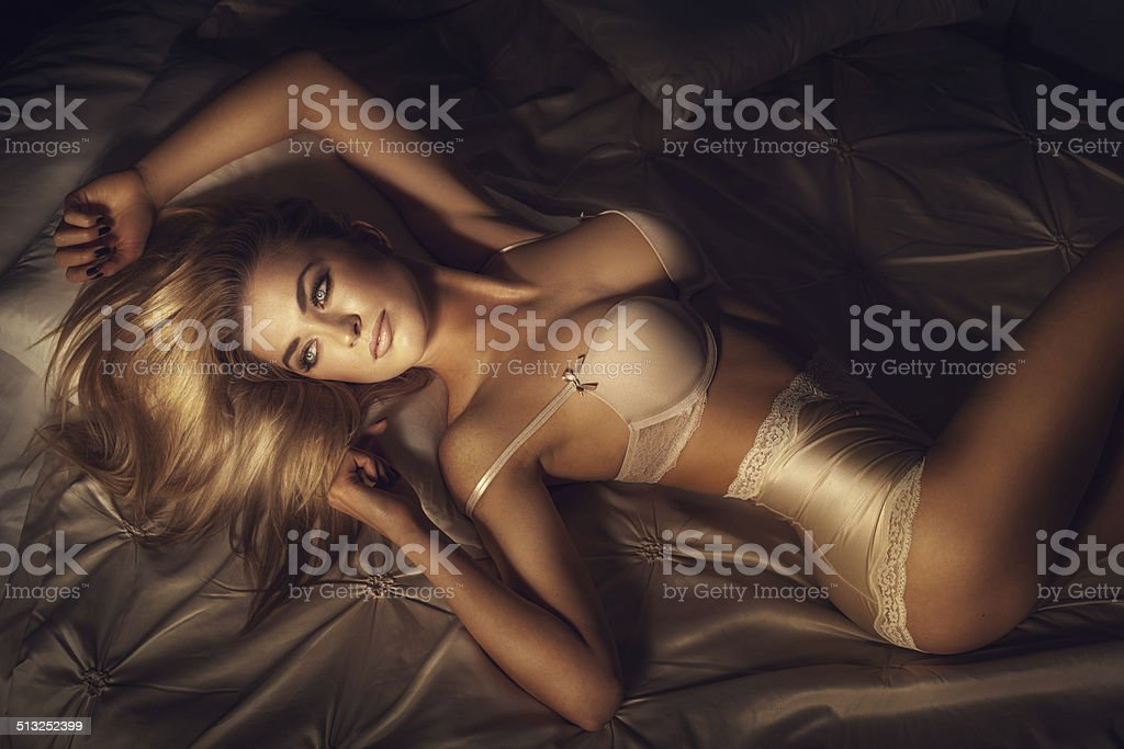 Sexy blonde lady posing stock photo