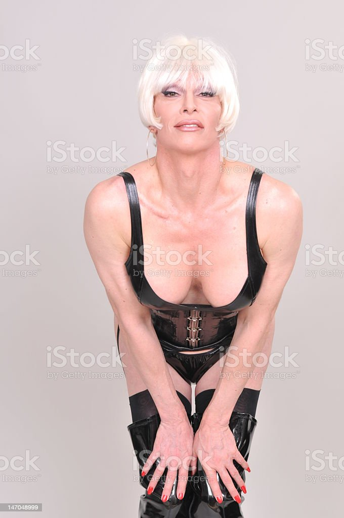 Sexy blonde transsexual wearing a sensual corset. royalty-free stock photo