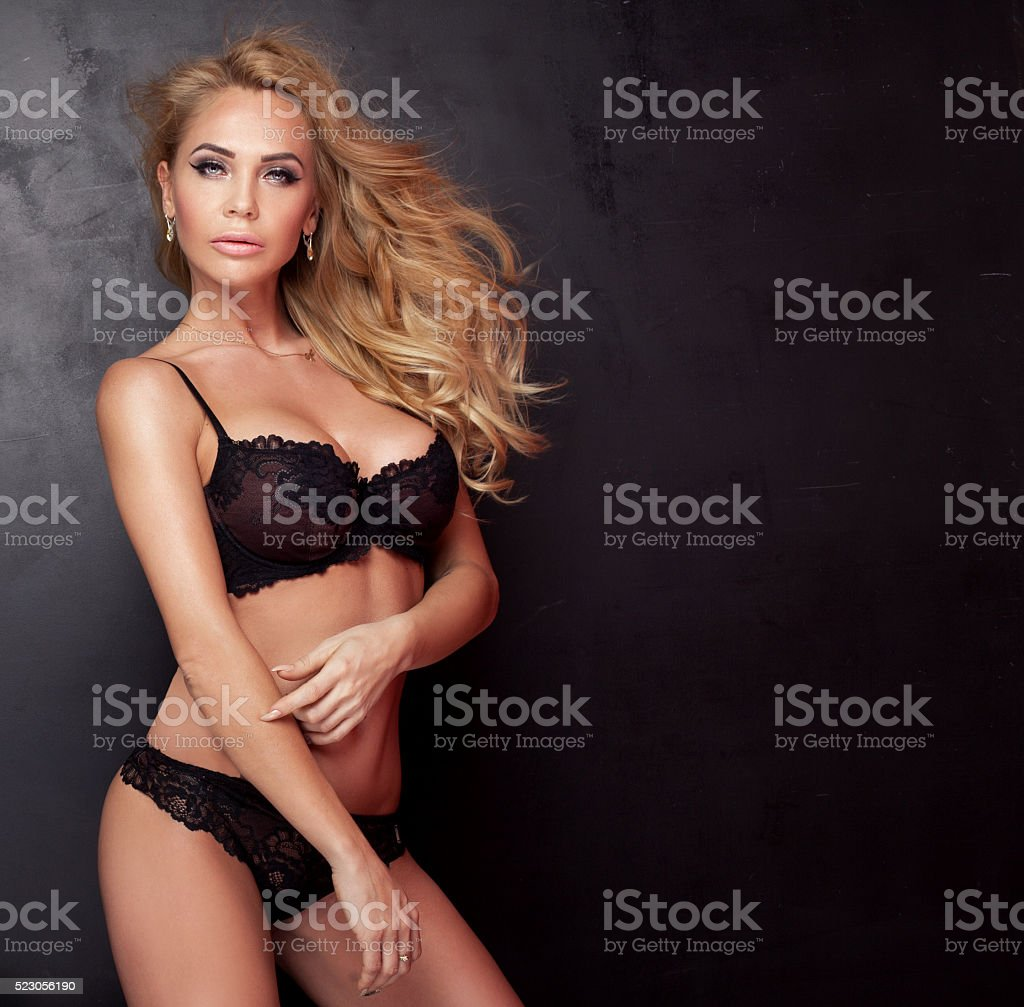 Sexy blonde woman in lingerie posing. stock photo