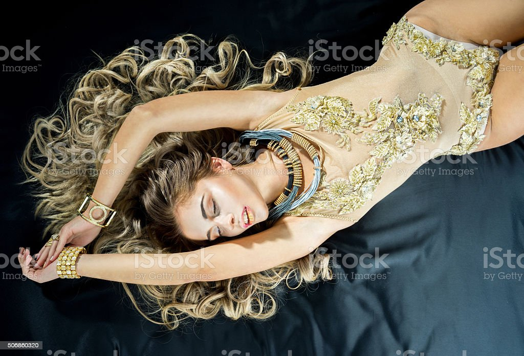 Sexy blonde woman in the bed stock photo