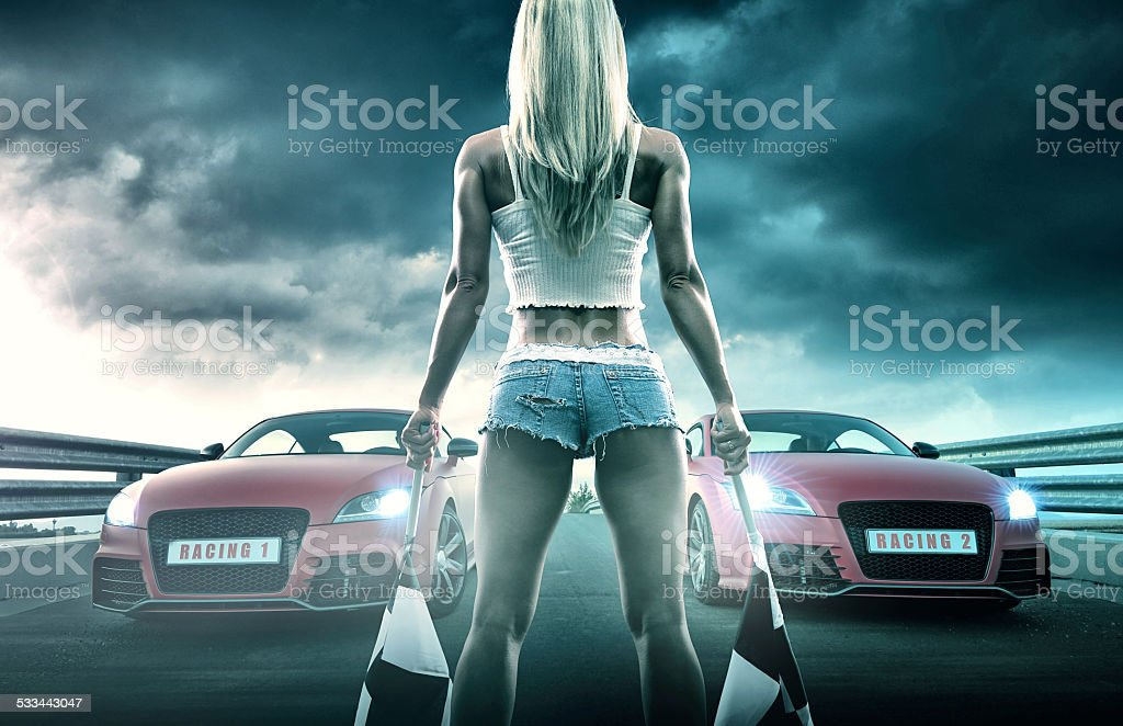 Sexy blonde woman starts racing stock photo