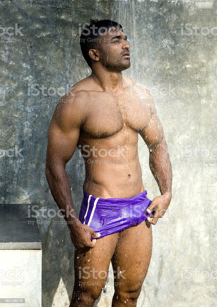 sexy bodybuilder showers before a swim stock photo