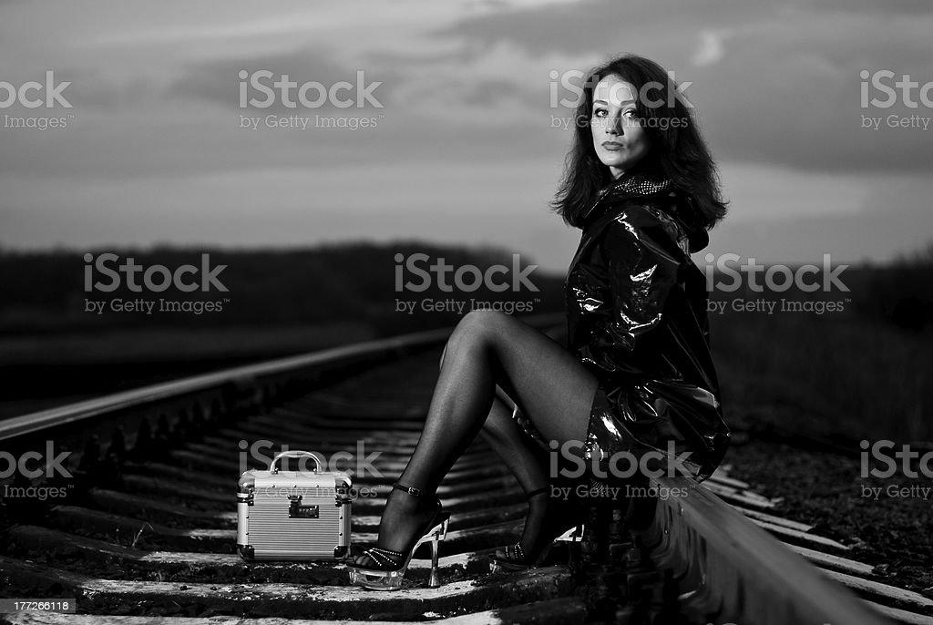 sexy brunet at railway stock photo