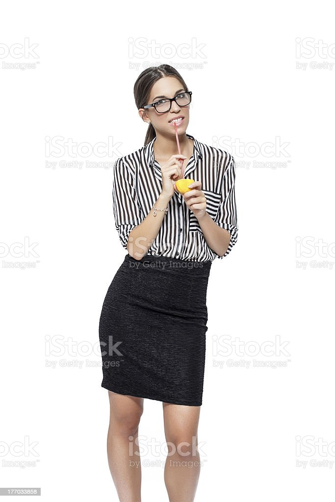Sexy brunette businesswoman drinking lemon juice royalty-free stock photo