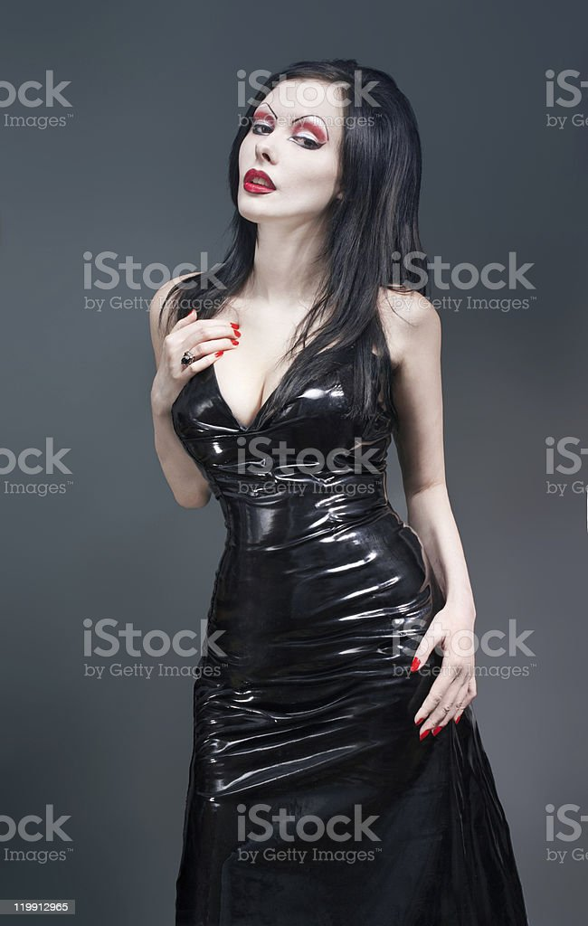 Sexy brunette gothic woman in black latex dress royalty-free stock photo
