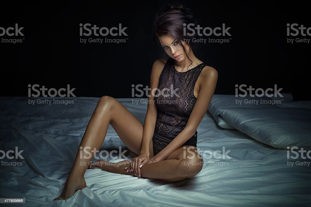 Sexy brunette lady in lingerie. stock photo