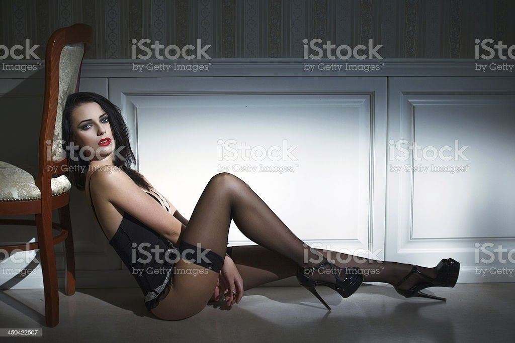 Sexy brunette model sitting on the floor royalty-free stock photo