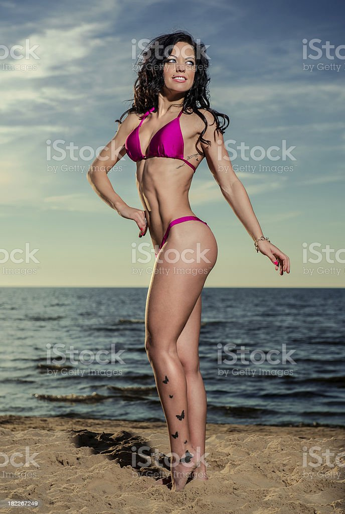 Sexy brunette on the beach royalty-free stock photo