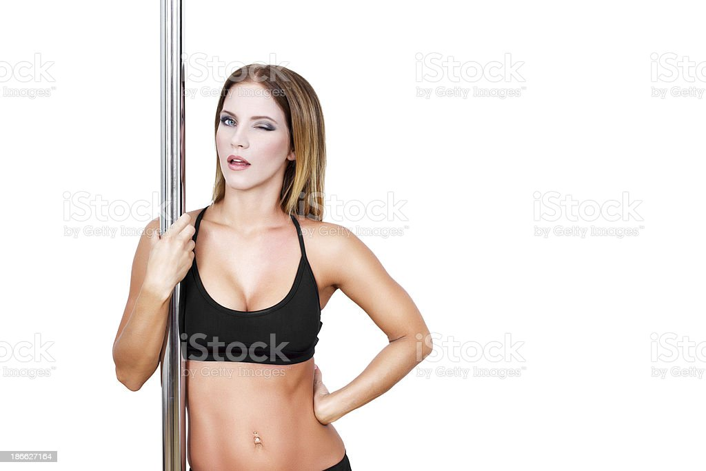Sexy brunette pole dancer royalty-free stock photo