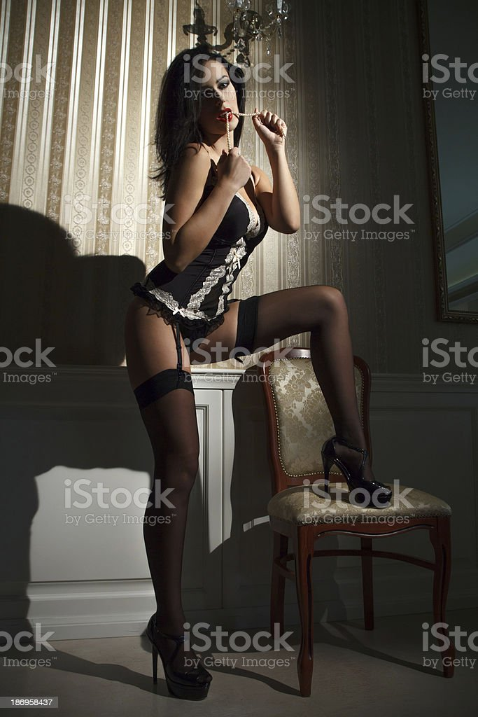 Sexy brunette woman at evening royalty-free stock photo