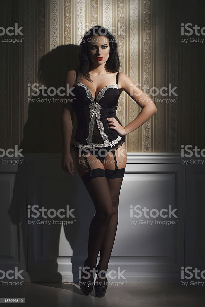 Sexy brunette woman at night posing royalty-free stock photo