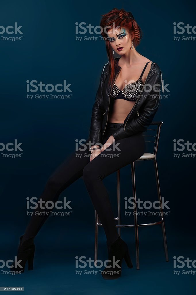 Sexy brunette woman in leather jacket in bra royalty-free stock photo