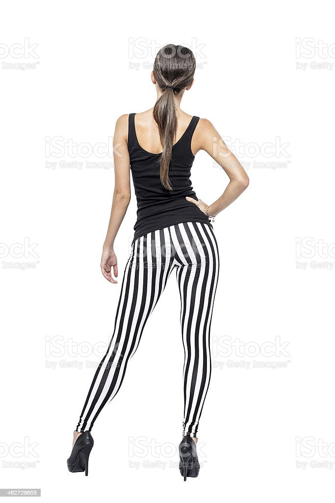 Sexy brunette woman in striped leggings royalty-free stock photo