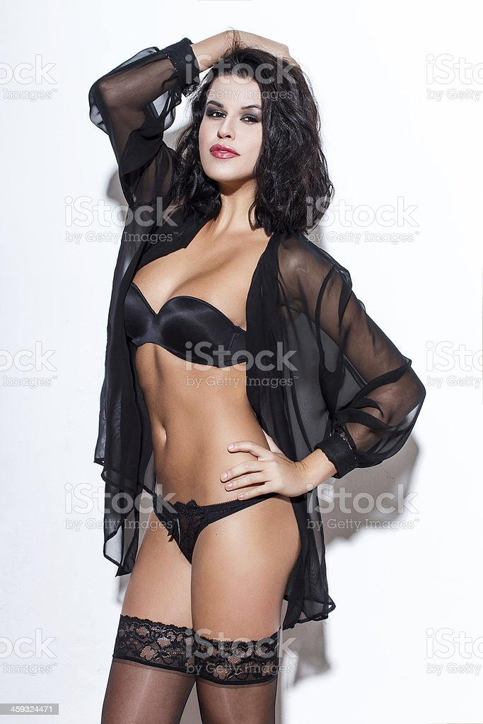 Sexy brunette woman posing at wall royalty-free stock photo