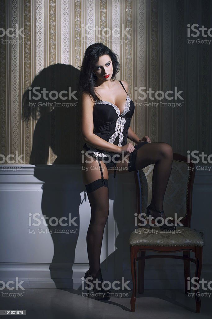 Sexy brunette woman pull down stockings royalty-free stock photo