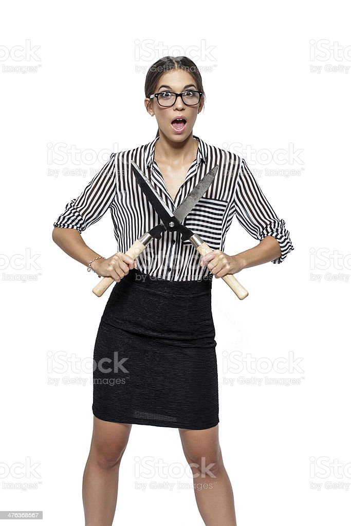Sexy brunette woman with hedge trimmer royalty-free stock photo
