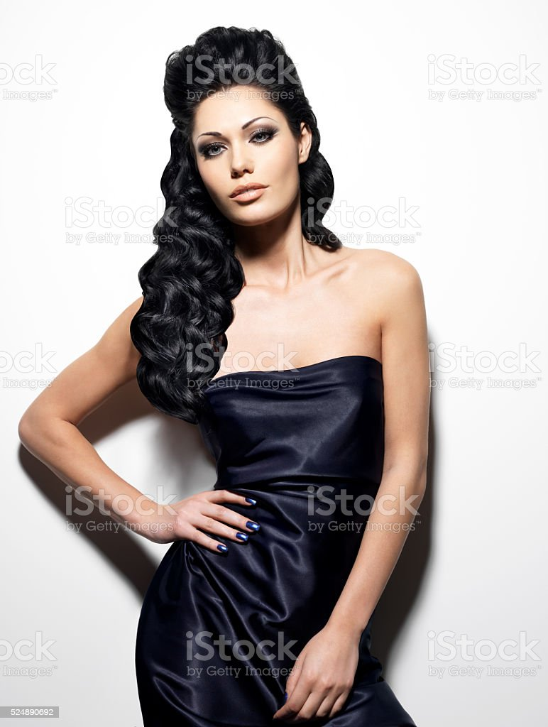 Sexy brunette woman with long hair stock photo